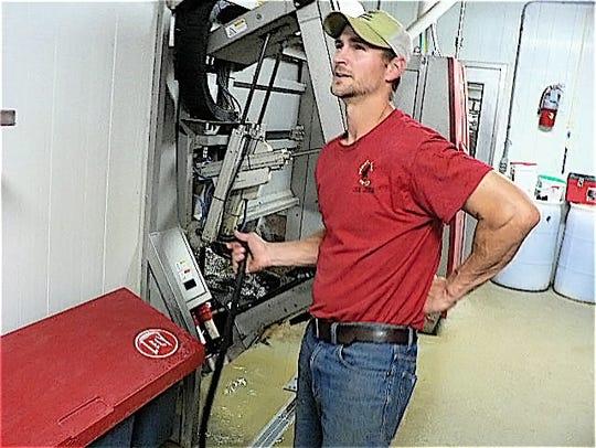 Jason Leedle as herdsman oversees the milk dumping at Black Cat Dairy.