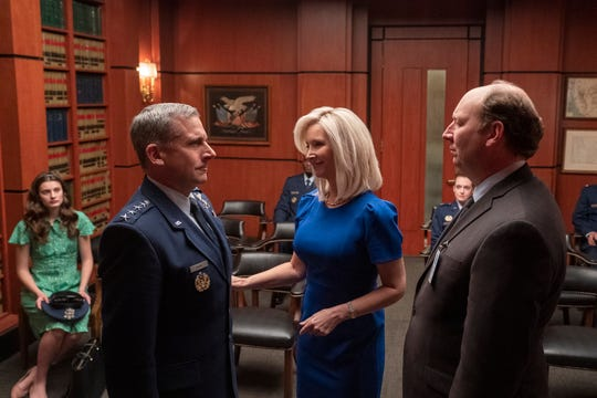 """Lisa Kudrow, center, as Maggie Naird in Episode 1 of """"Space Force."""""""