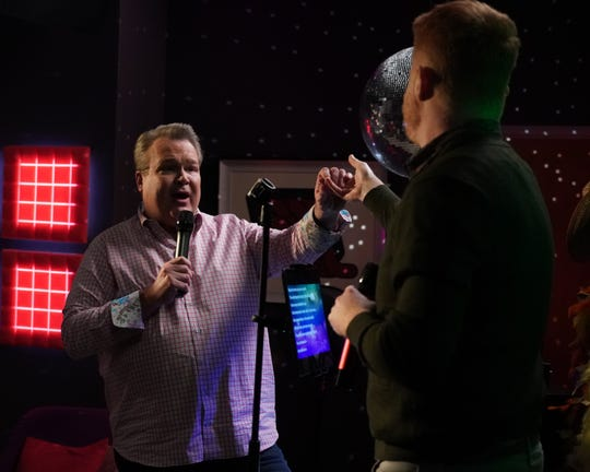 Cam (Eric Stonestreet), left, and husband Mitchell (Jesse Tyler Ferguson) perform a duet and make a major life decision in the series finale of ABC's 'Modern Family.'