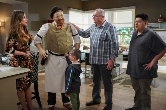 Gloria (Sofia Vergara), left, has issues with a housewarming gift selected by husband Jay (Ed O'Neill) as sons Joe (Jeremy Maguire) and Manny (Rico Rodriguez) look on in the series finale of ABC's 'Modern Family.'