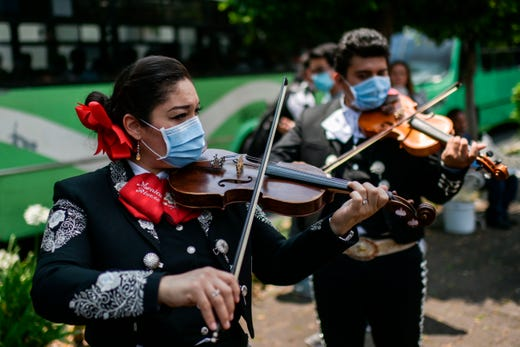 A mariachi band serenades the National Institute of Respiratory Diseases (INER) in Mexico City, on April 7, 2020 to give hope to those fighting COVID-19 and the medical personnel during the coronavirus pandemic.  The serenade was organized by the Tequila and Mezcal Museum with the aim of encouraging the sick and medical personnel and the whole of Mexico during the COVID-19 pandemic.