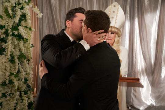 The inimitable Moira (Catherine O'Hara) marries David (Dan Levy) and Patrick (Noah Reid).