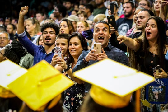 Family and friends cheer for their graduates as they enter the arena during the Lehigh Senior High School graduation ceremony at Alico Arena in Estero last May. This year's seniors and their parents worry they won't get to enjoy the experience because of coronavirus closures.