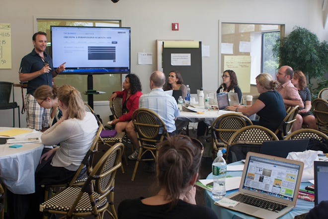 Veteran teachers attend a Blended Learning Institute workshop in Manhattan in 2014. Experts say teachers need weeks, if not months, of training to develop and implement an online class. Many districts provided teachers a crash course in using online platforms, as fears around the spread of COVID-19 shut down schools.