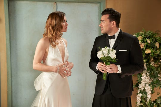 Ew, David! Is Alexis (Annie Murphy) wearing a wedding gown to walk her brother (Dan Levy) down the aisle?