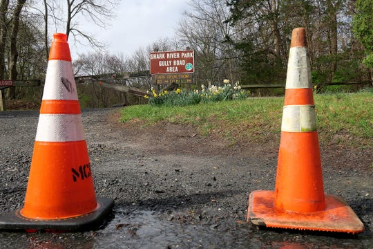 Traffic cones block the Gulley Road entrance to the Shark River Park in Neptune Township Thursday, April 9, 2020.