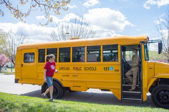 Buncombe County Schools bus driver Melissa Mobley and her assistant Dan Smith get ready to head to another location.