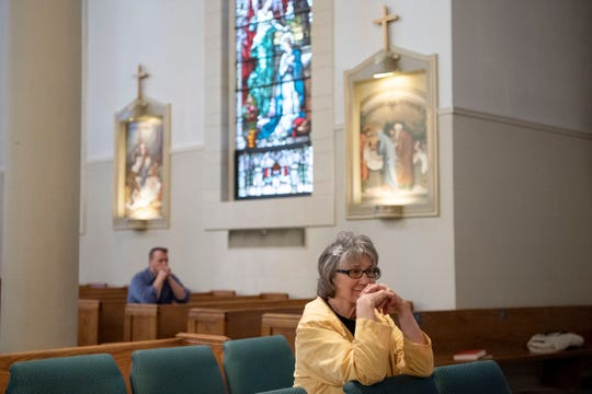 Sandy Bosrock prays during Holy Week confession at St. Philip Roman Catholic Church on Wednesday, April 8, 2020 in Battle Creek, Mich. To prevent the spread of COVID-19, only 10 people are allowed inside the church at a time.