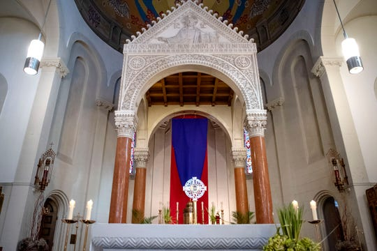 To prevent the spread of COVID-19, only 8 people are allowed inside the church at a time during Holy Week confession at St. Philip Roman Catholic Church on Wednesday, April 8, 2020 in Battle Creek, Mich.