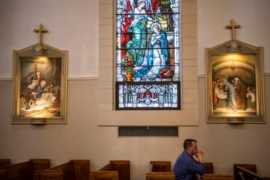 To prevent the spread of COVID-19, only 10 people are allowed inside the church at a time during Holy Week confession at St. Philip Roman Catholic Church on Wednesday, April 8, 2020 in Battle Creek, Mich.