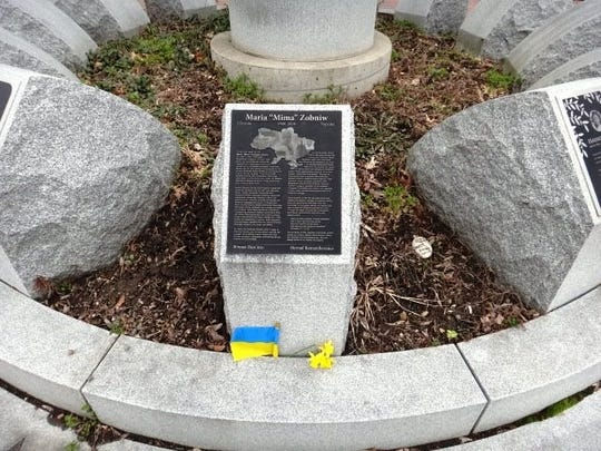 Lubomyr Zobniw placed daffodils at the stone memorial to his wife, Mima, at the ACA memorial on April 3, 2020.