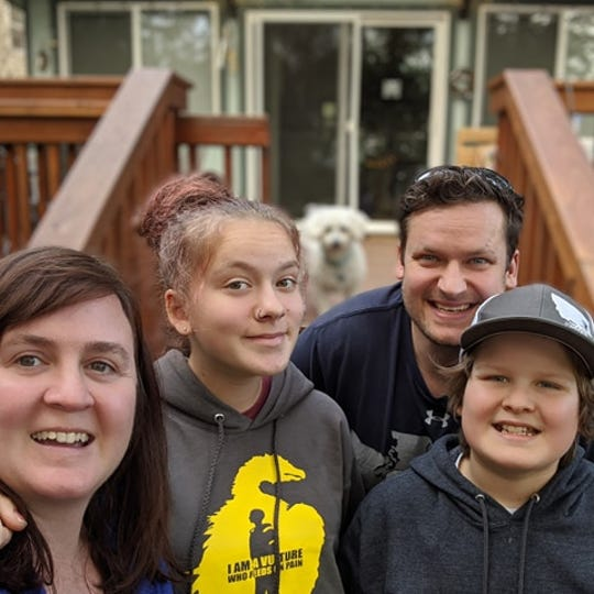 Misty Nault, left, and her family pose for a photo. Nault and her husband, who has asthma, have decided to live apart until the danger of the coronavirus outbreak passes.