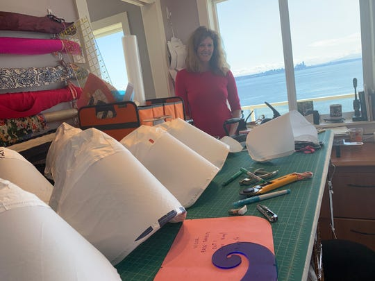Islander Leah Boyan with some of the PAPR hoods she has been working on.