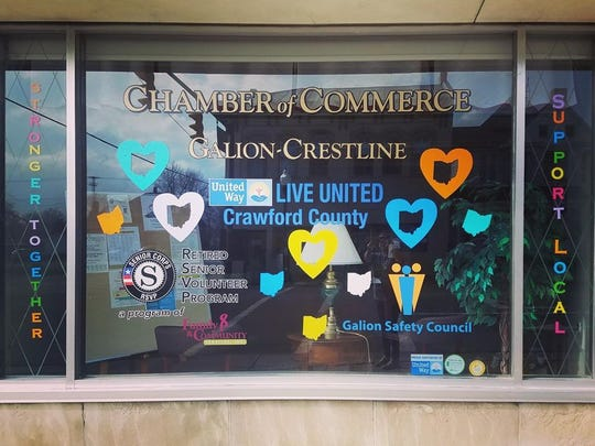 """The front window of the Galion-Crestline Area Chamber of Commerce has been decorated to show support for the community. One side says """"Stronger Together"""" and the other says """"Support Local."""""""