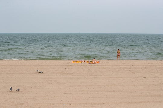 Two people enjoy Corpus Christi's North Beach.