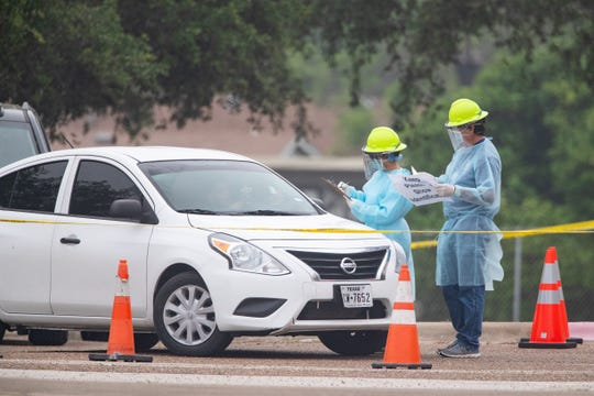 Heath care workers conduct COVID-19 testing at the Corpus Christi's drive-thru testing center at the old Christus Spohn Memorial Hospital parking lot on Thursdays, April 9, 2020.