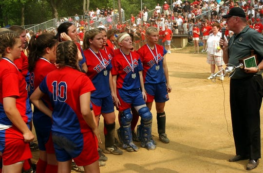 The Zane Trace Lady Pioneers are presented the trophy for runner up in the statewide Division lll championship softball tournament at Ashland in 2005.