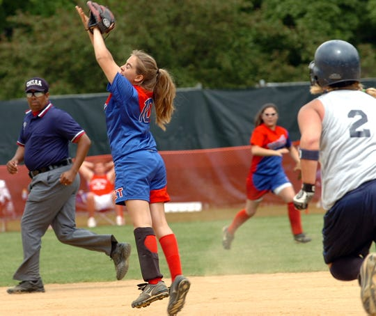 Zane Trace infielder Courtney Bloomfield makes the catch of the day for the winning out in the 5th inning for a 15 to 0 victory against the Blanchester Wildcats at the Division lll semifinal game in 2005.