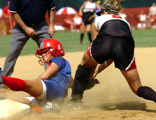 Zane Trace's Rylie Hill beats the throw at third base in the bottom half of the third inning at the  Division lll championship game in 2005.