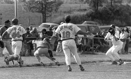 A Wheelersburg player gets caught in a rundown between bases. Unioto defeated Wheelersburg 9-6 in a Division III district semifinal game in May 1994.