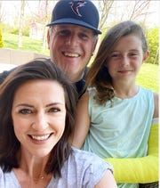 Brian Heid (top) with his wife, Kelly, and daughter Harper. Harper's broken arm was treated at Beacon Orthopaedics on the West Side.