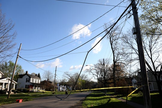 Storm damage seen on Center Street in Old Milford on Thursday morning. Trees and power lines are down across the region as a powerful storm with high winds ripped through overnight.