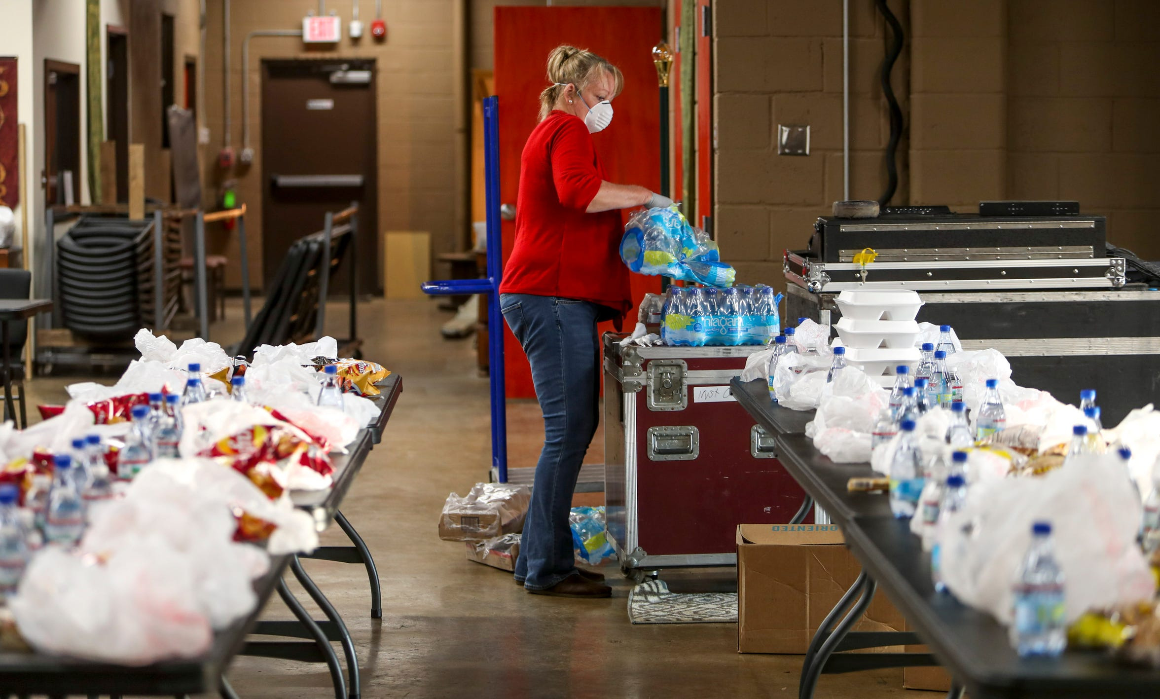 Ellen McGillvary organizes bags to be distributed with hot meals at Manna Cafe Ministries in Clarksville, Tenn., on Wednesday, April 8, 2020.