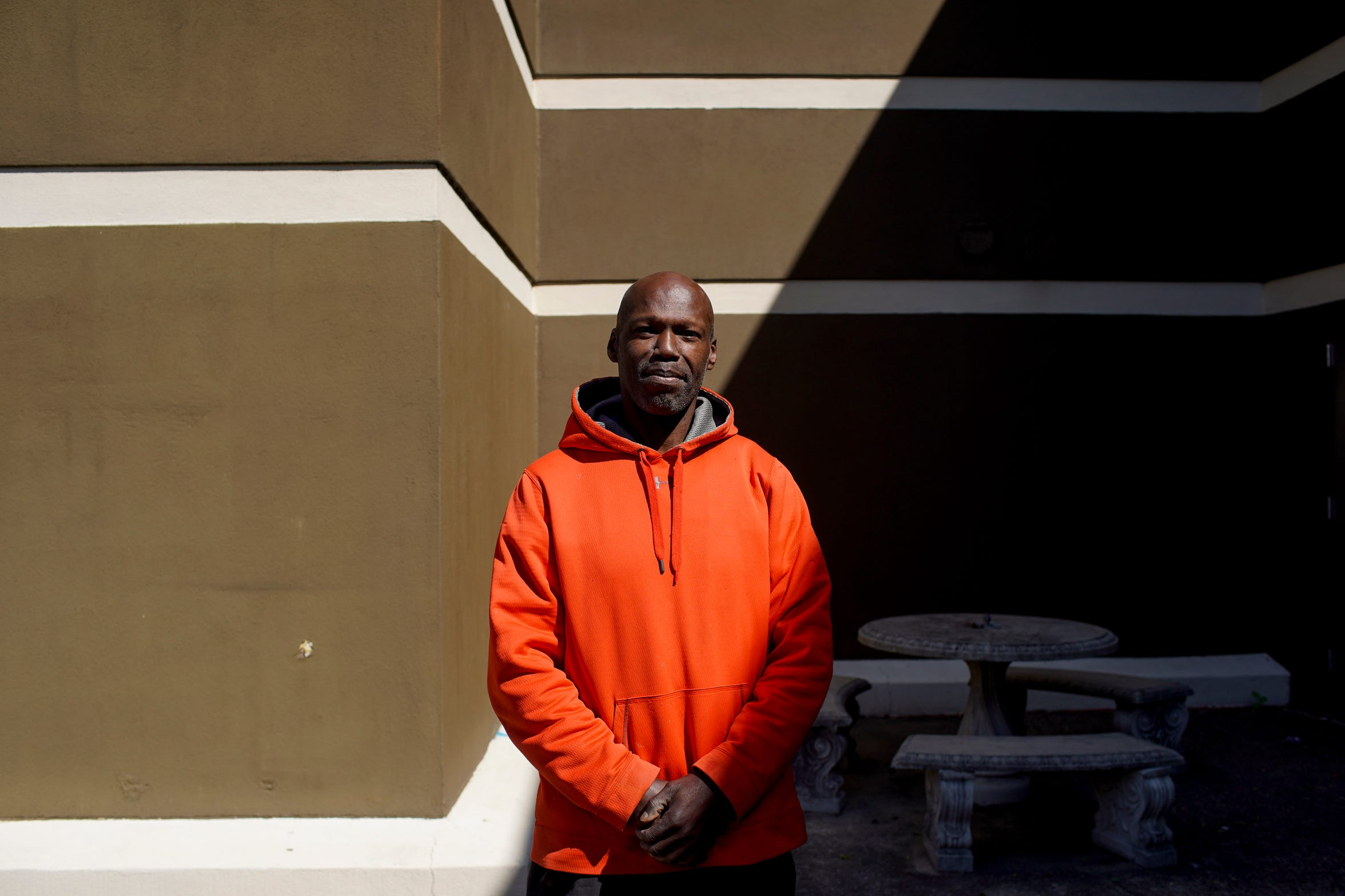 Mark Mosley stands in the light to pose for a portrait after picking up some resources at YAIPaks center in Clarksville, Tenn., on Thursday, April 9, 2020.