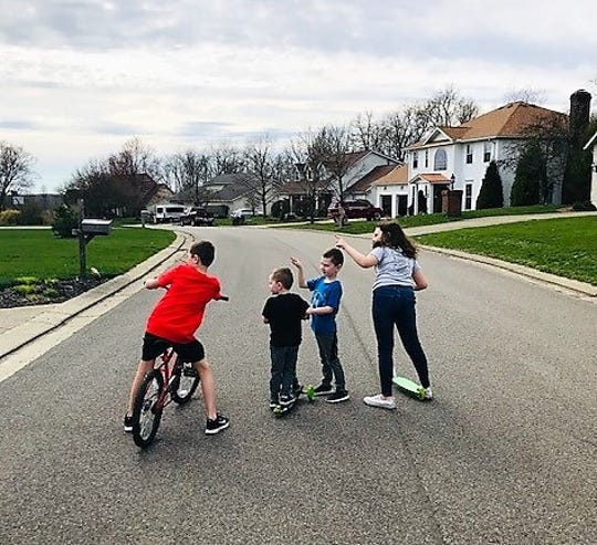 The children of Erin Tipton point out a picture of a rainbow in a window on Ridgewood Drive to their youngest borther, Ewan, 3. The other children are Easton, 8, Eydan, 5, and Everly, 9. Erin spearheaded the scavenger hunt for children to find pictures in windows in their neighborhood.