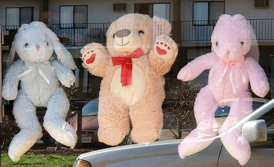 Stuffed animals in the window of Anchor Church are part of the Coshocton County Bear Hunt group.