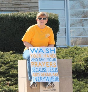 St. Augustin teacher Therese Drey shares a message for her students during the April 7, 2020 St. Augustin Catholic School drive through.