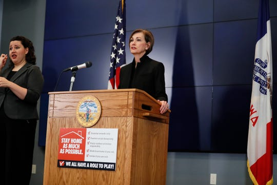 Iowa Gov. Kim Reynolds updates the state's response to the coronavirus outbreak during a news conference at the State Emergency Operations Center, Thursday, April 9, 2020, in Johnston, Iowa. (AP Photo/Charlie Neibergall, pool)