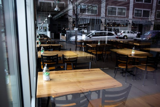The tables and chairs inside the Scenic Route Bakery in Des Moines' East Village sit empty because of the coronavirus on Thursday, April 9, 2020.