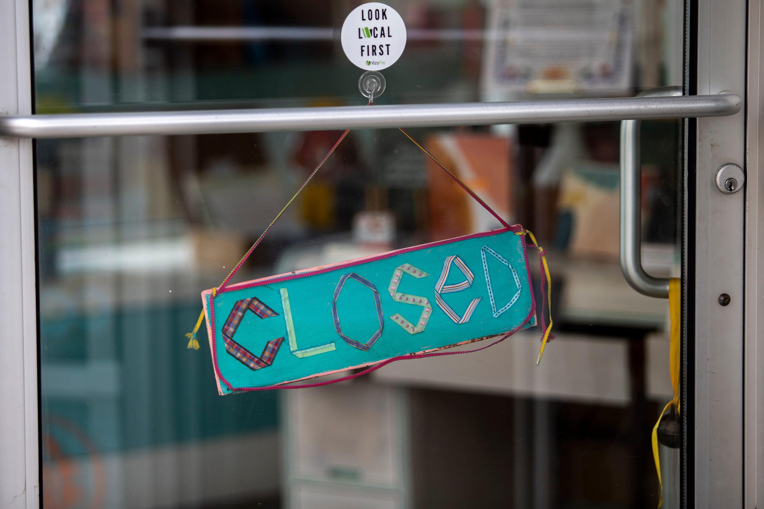 Closed sign on local business