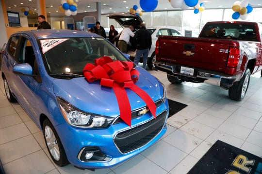 In a photo from Thursday, Dec. 28, 2017, people walk through the Taylor Chevrolet showroom in Taylor, Mich. At car dealerships, they call it the payment walk, when someone with a low credit score wants to buy a new car but gets walked to the used lot because they can't qualify for a new-car loan. As the Federal Reserve continues its string of interest rate increases, auto dealers and industry analysts say more people will be taking the walk because interest rates, and monthly payments are on the rise.