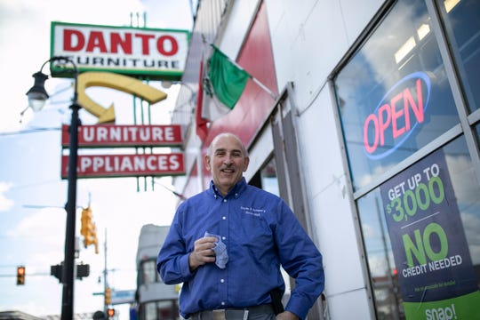 Irwin Danto stands outside of his furniture business in Detroit on April 9, 2020, during the Novel Coronavirus outbreak.