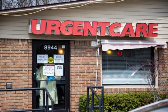 At Downriver Urgent Care, registered nurse Lori Khaled keeps the door locked on Thursday at the Grosse Ile facility.
