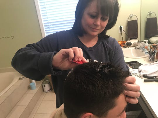 Teresa Seidel cuts the hair of her son, Nick Seidel, in April 2020 during the novel coronavirus pandemic. Teresa is the wife of Free Press columnist Jeff Seidel, and Nick is one of his sons.