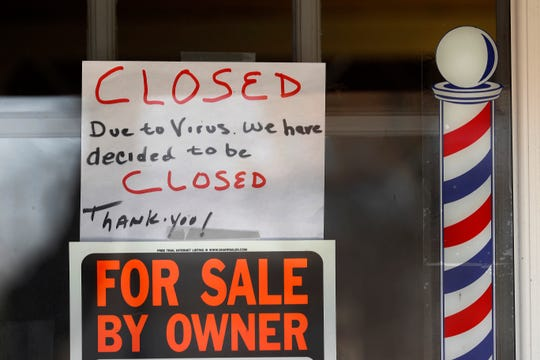 """For Sale By Owner"" and ""Closed Due to Virus"" signs are displayed in the window of Images On Mack in Grosse Pointe Woods, Thursday, April 2, 2020."