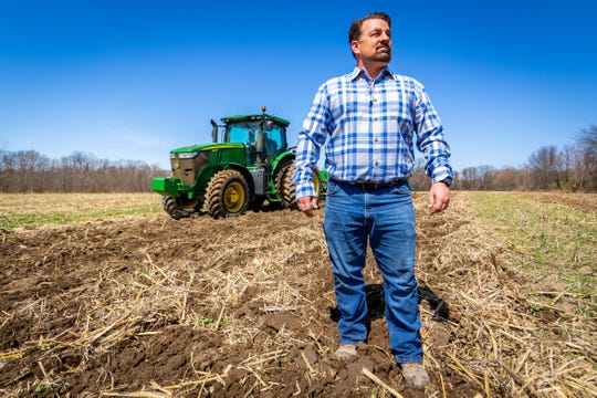Matt Nilson, Director of Business Operations for Golden Plain Farms, surveys a field being plowed for bell pepper planting on April 8, 2020 in Watervliet, Mich. Farmers across the state say they are concerned about not getting migrant labor from Mexico they need this year because of the coronavirus outbreak.