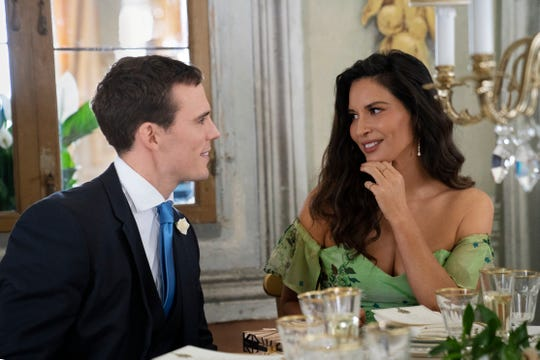 "Sam Claflin and Olivia Munn in ""Love Wedding Repeat."""
