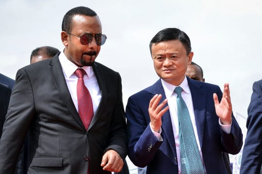"""Alibaba Group co-founder Jack Ma, right, walks with Ethiopia's President Abiy Ahmed, left, at the """"Ethio ICT Village"""" in the capital Addis Ababa, Ethiopia, on Nov. 25, 2019."""