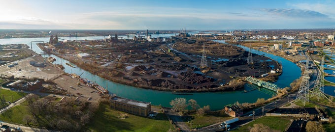 The bridge at the upper left in this recent drone photograph doubles as a railroad trestle and is the main entrance to Great Lakes Works on Zug Island. The two tall structures beyond the bridge are the A and B furnaces, idled respectively around 2000 and last summer. The similar dark tower to their right is blast furnace D, which may have produced its last iron in late March. The bridge at the lower right, known as the Gap Gate, is rarely used.