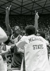 Michigan State's Magic Johnson celebrates the Spartans' NCAA championship in 1979.