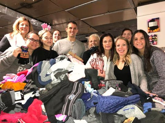 A group of nurses from Henry Ford Health System take part in a recent Mittens for Detroit BigSort of donated winter accessories.