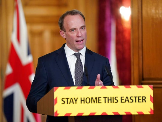 In this handout photo provided by 10 Downing Street, Britain's Foreign Secretary Dominic Raab speaks during a media briefing on coronavirus in Downing Street, London, Thursday, April 9, 2020.