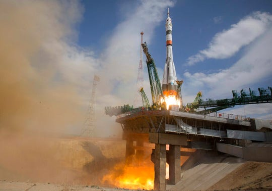 In this handout photo released by Roscosmos Space Agency Press Service the Soyuz-2.1A rocket booster with Soyuz MS-16 space ship carrying a new crew to the International Space Station, ISS, blasts off at the Russian leased Baikonur cosmodrome, Kazakhstan, Thursday, April 9, 2020.