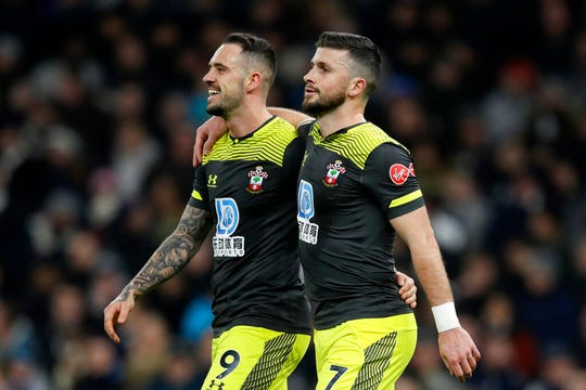 Southampton's Shane Long, right, celebrates with Danny Ings after scoring his side's first goal during the English FA Cup fourth round replay soccer match between Tottenham Hotspur and Southampton at the Tottenham Hotspur Stadium in London, Wednesday, Feb. 5, 2020.