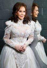 """In this Feb. 10, 2016 file photo, Loretta Lynn poses for a photo at the Municipal Auditorium in Nashville, Tenn. Lynn's new book, """"Me & Patsy Kickin' Up Dust: My Friendship with Patsy Cline,"""" was released on Tuesday, April 7."""