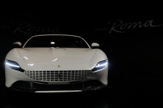 The Ferrari Roma car is unveiled in Rome, Thursday, Nov. 14, 2019. Ferrari unveils a new sports coupe aimed at enticing entry-level buyers and competing with the Porsche 911, part of a complete refresh of its model lineup by 2022.